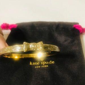 "Kate Spade ""Take a bow"" Gold Glitter Bangle."